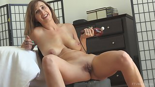 Mature brunette wife Alice masturbates with a vibrator on her clit
