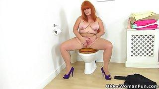 British milf Ginger Tiger gets filthy far bathroom