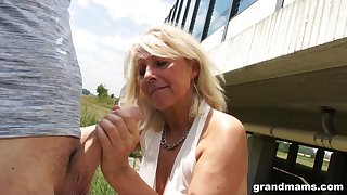 Slutty granny gives a blowjob in public and shows wet washed out panties