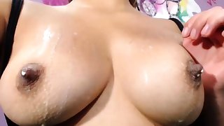 German chick with pierced nipples playing