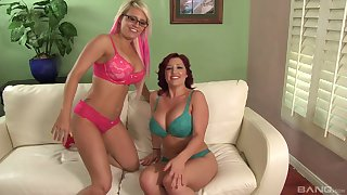 Girl on girl action between busty Jacky Joy and Dayna Joust